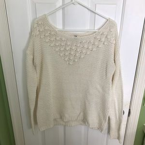 Long sleeve cream color sweater with pompops